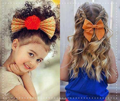 penteado enfeitado com laços para criança