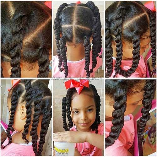 penteado infantil com laço em cabelo cacheado
