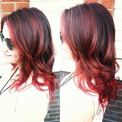 cabelo escuro iluminado com cores vermelhas