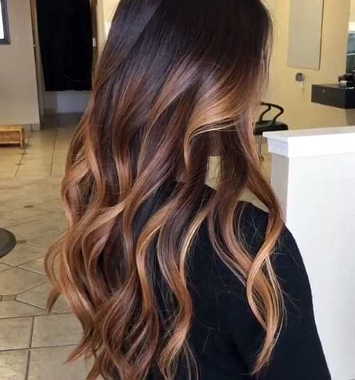 Brown hair with blonde highlights and caramel lowlights