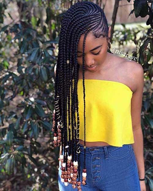 tranca afro jogado pro lado com enfeites bonitos