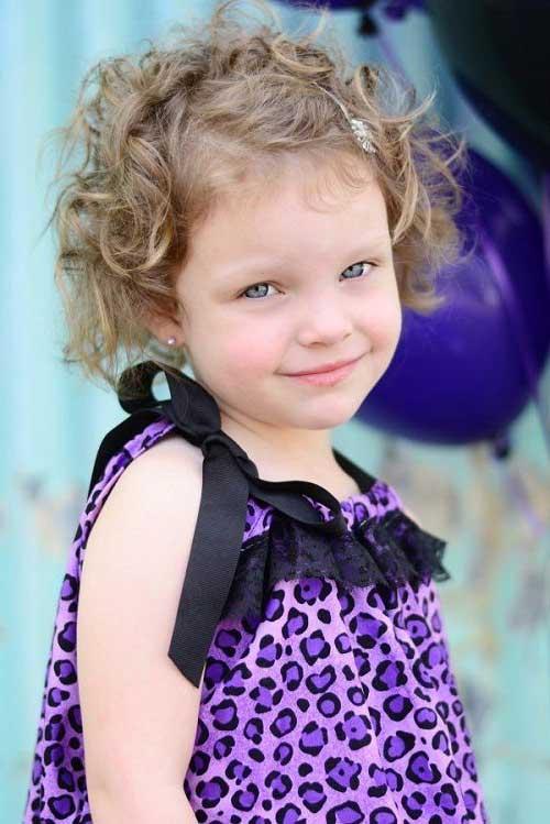 penteado infantil em cabelo cacheado curto