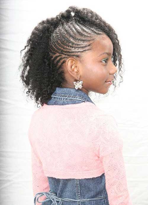 cabelo cacheado de menina negra com trancinha torcida
